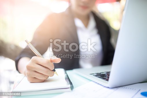 istock young women working and used computer, working concept. 1124339065