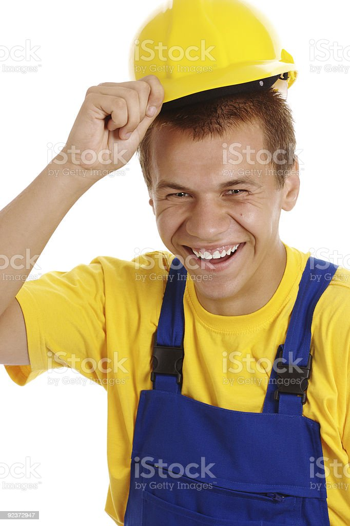 Young worker taking off his hard hat royalty-free stock photo
