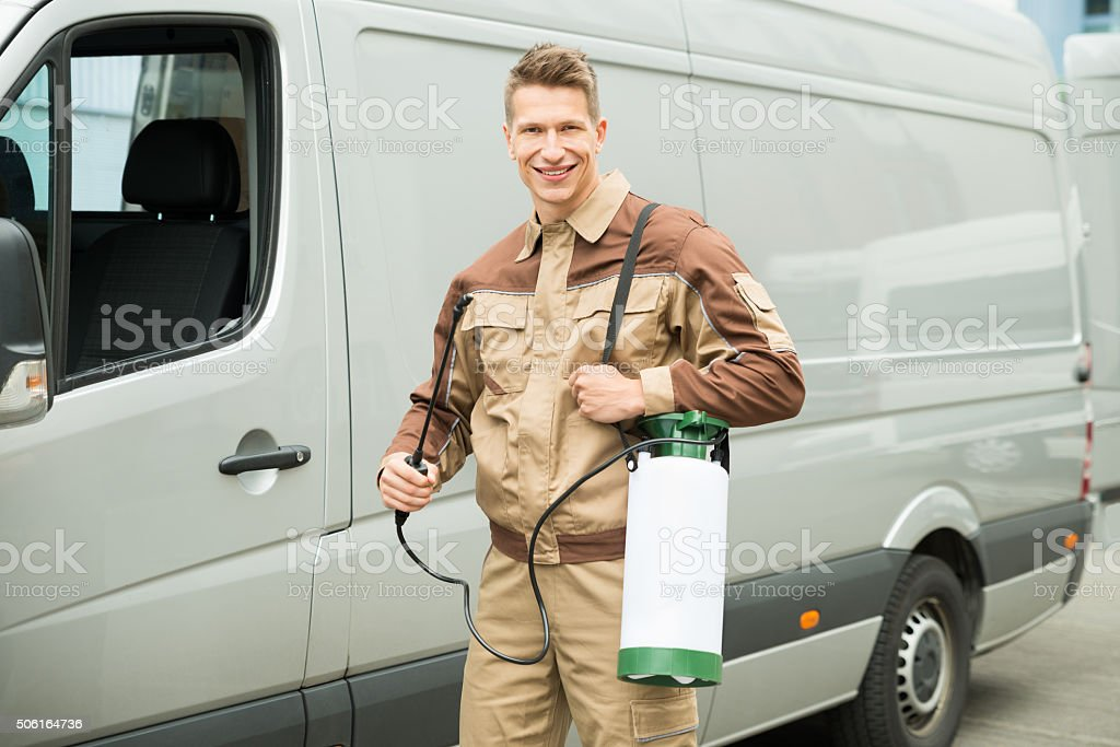 Young Worker With Pesticide In Front Van stock photo