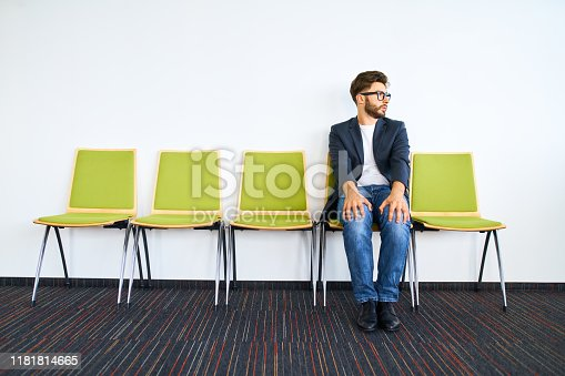 Young worried businessman waiting for job interview.