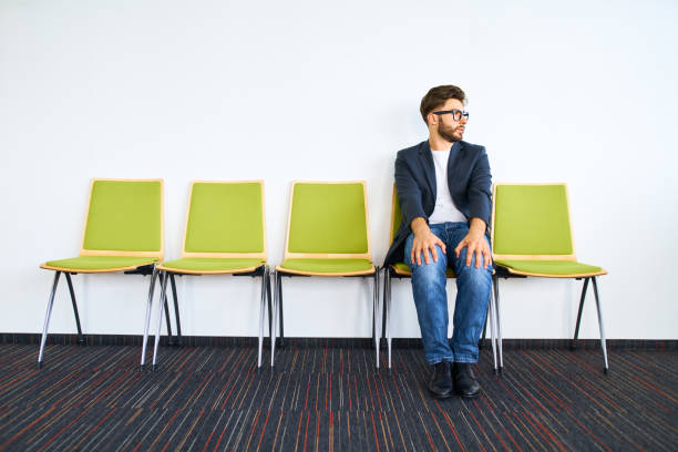 Young worried businessman waiting for job interview. stock photo