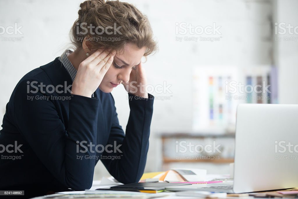 Young worried businesswoman stock photo