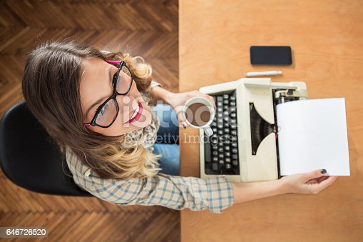 istock Young Writer Using Typing Machine 646726520