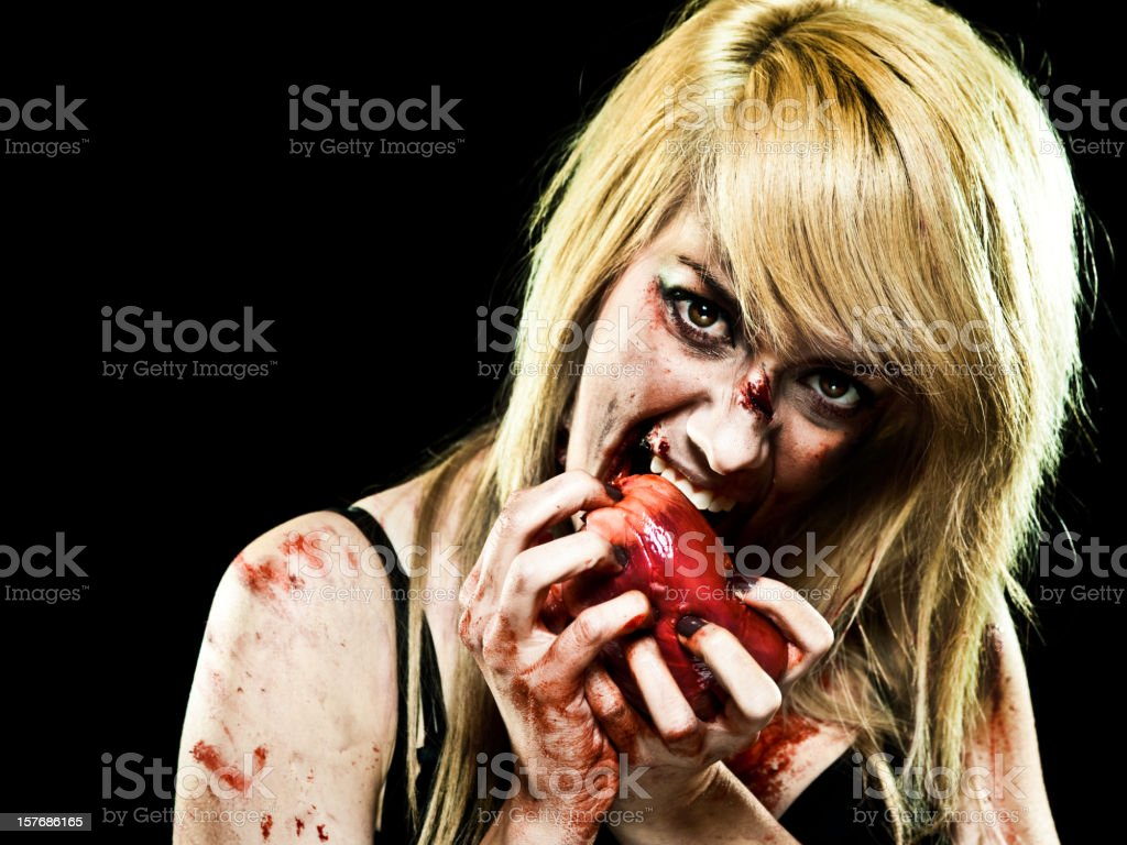 Young Zombie girl with a Human Heart stock photo