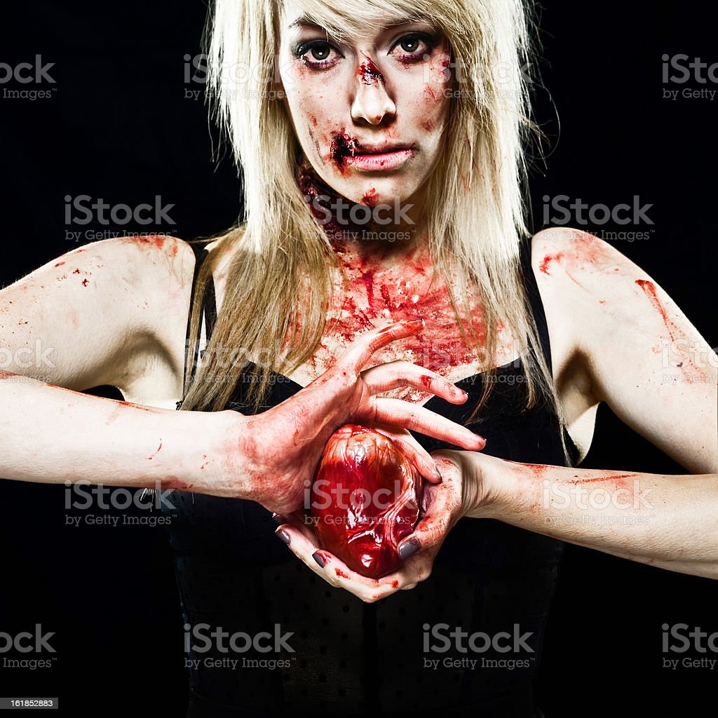 Young Zombie girl with a Human Heart royalty-free stock photo