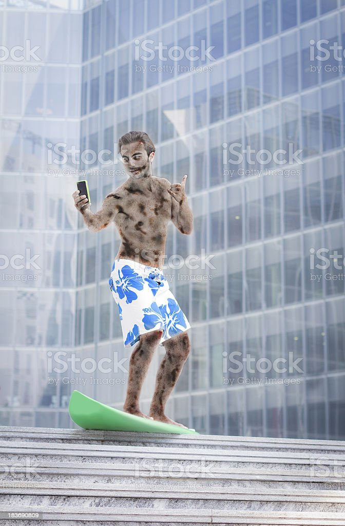 Young zombie surf with smart phone outside office stock photo