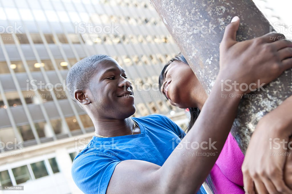 Younge couple having fun in the city downtown - IV royalty-free stock photo