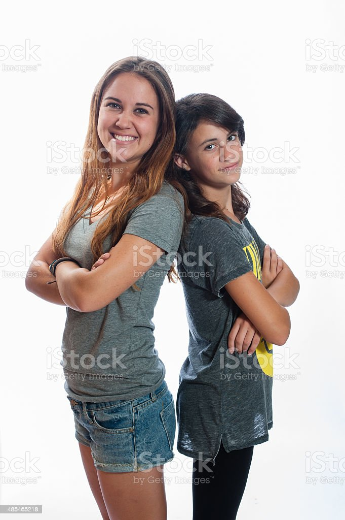 Younger sibling gaining in height stock photo