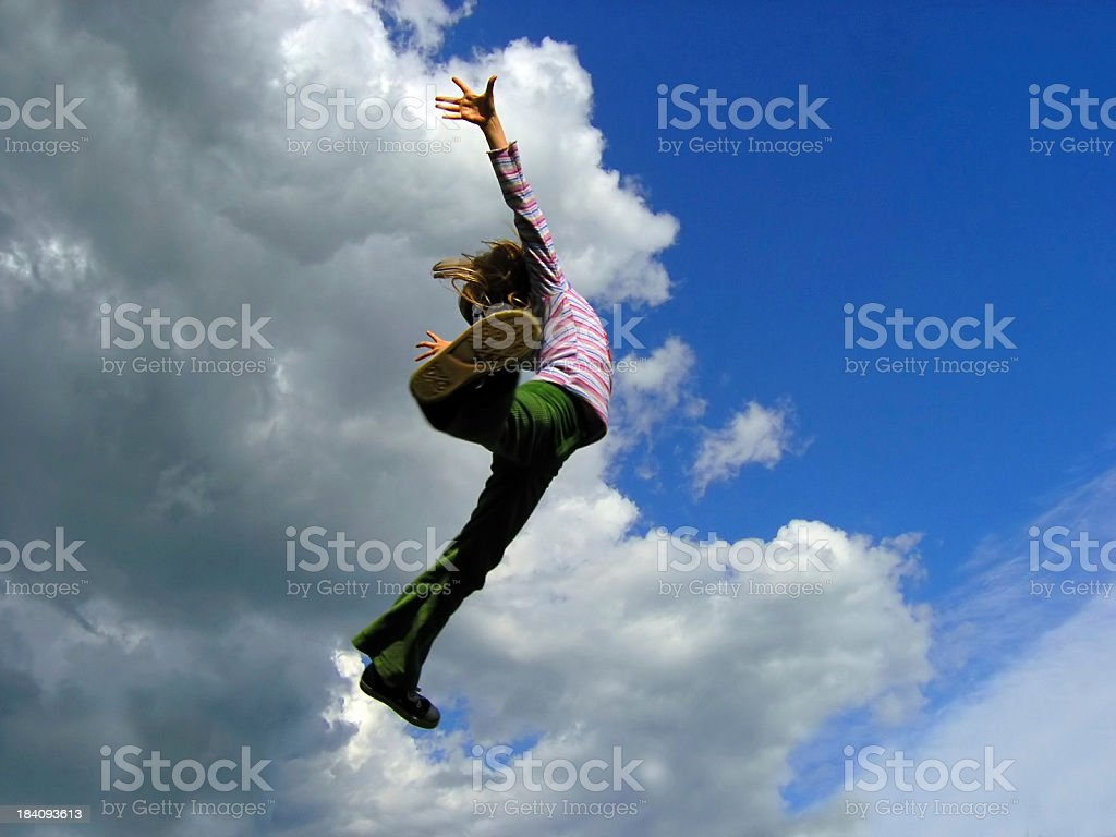 younggirl's jump to sky stock photo