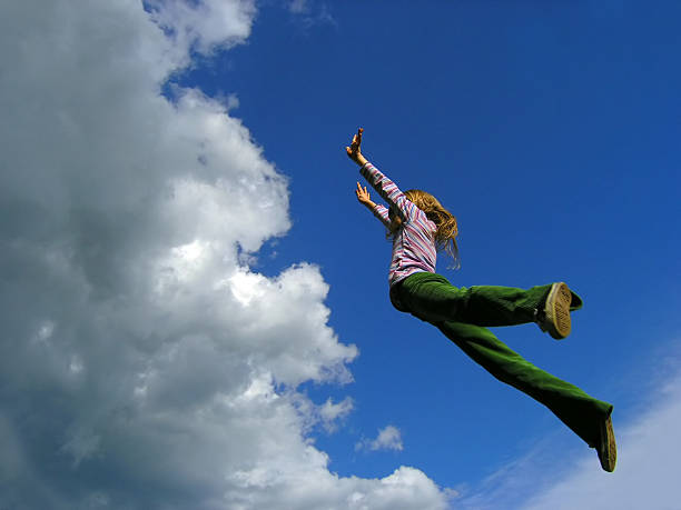 younggirl's jump to sky (2) stock photo