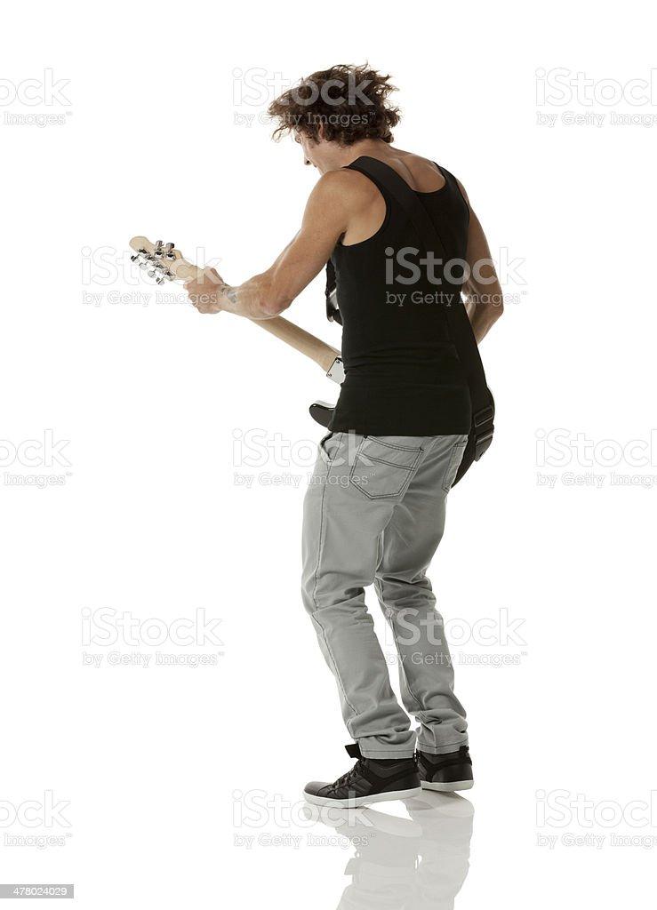 Youngman playing guitar royalty-free stock photo