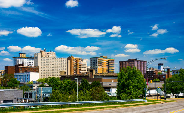 Youngstown, Ohio Skyline With Puffy Clouds Downtown Youngstown skyline with a dramatic cloudscape of puffy white clouds with a deep blue sky backdrop.  Youngstown is part of the Mahoning Valley area. ohio stock pictures, royalty-free photos & images
