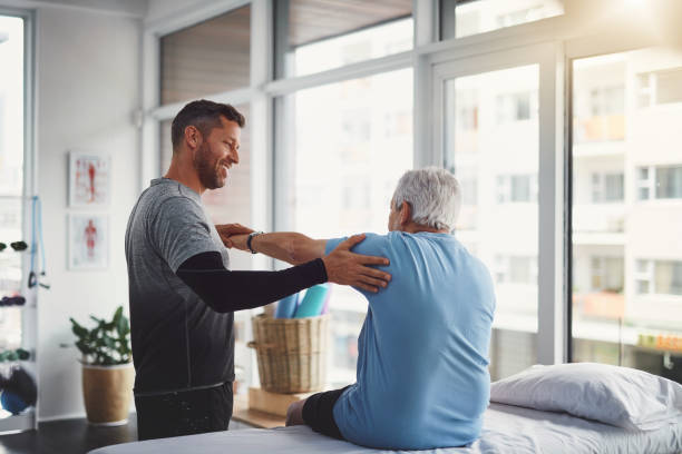 Your body seems to be recovering well Shot of a young male physiotherapist assisting a senior patient in recovery recovery stock pictures, royalty-free photos & images