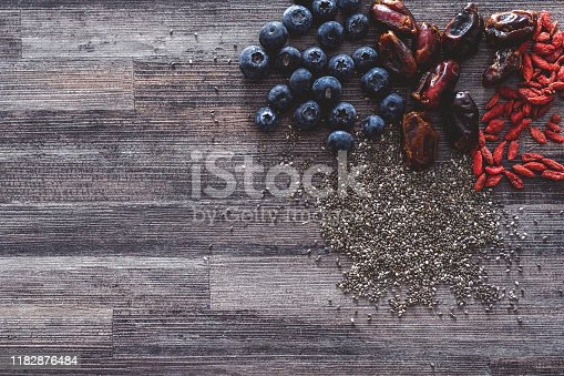 Shot of a bunch of super foods laying on a wooden background
