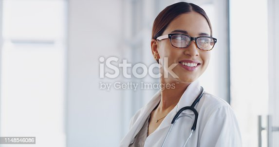 Shot of a confident young doctor working in a modern hospital