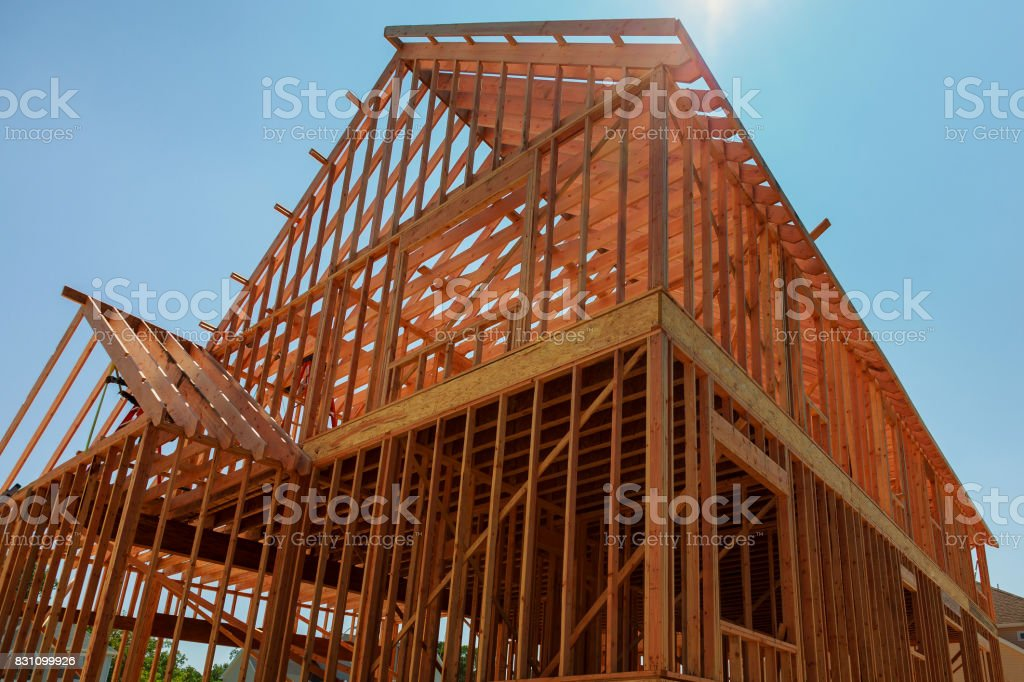 Your dream home. New residential construction house framing stock photo