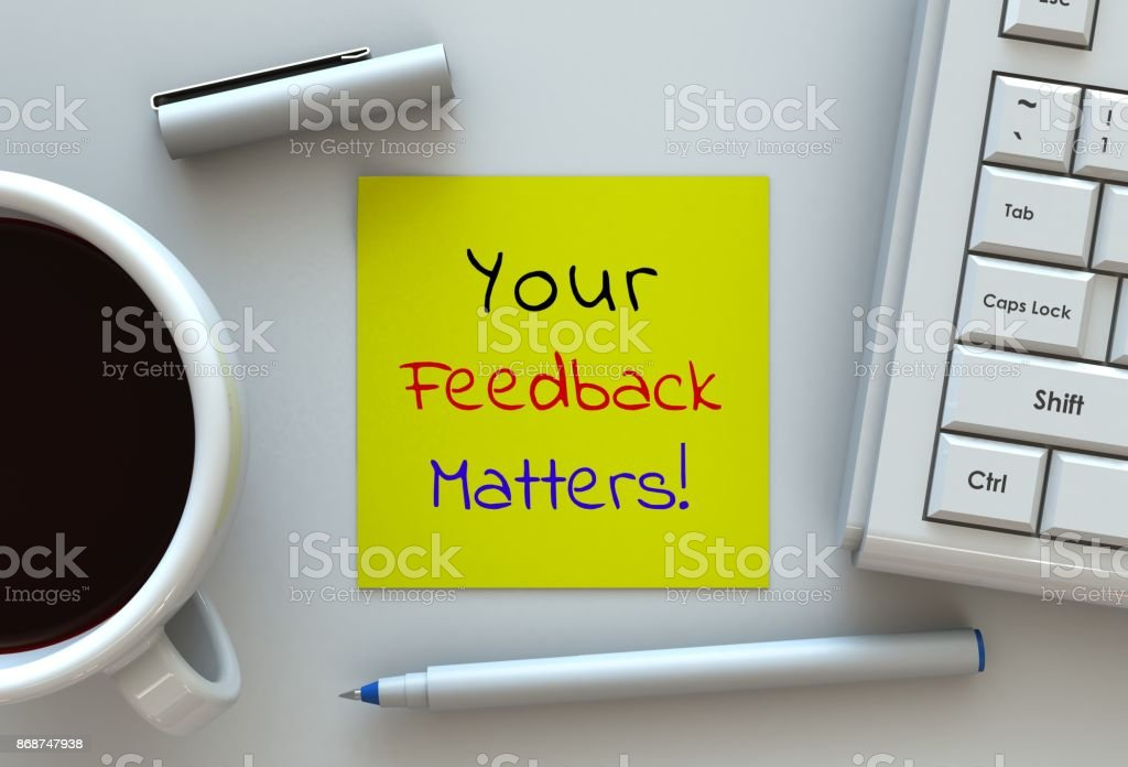 Your Feedback Matters, message on note paper, computer and coffee on table stock photo