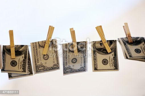 Five American bank notes being hung up to dry and held secure by pegshttp://195.154.178.81/DATA/i_collage/pi/shoots/781058.jpg