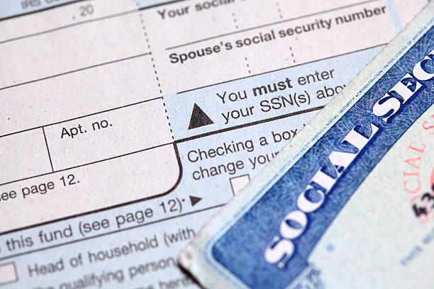 Your Identity shotof social security card and tax form social security stock pictures, royalty-free photos & images