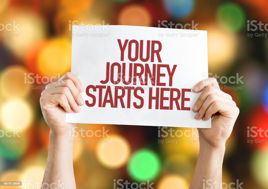 Your Journey Starts Here sign stock photo