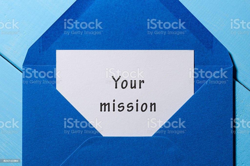 Your mission inscription in blue mail envelope. Motivation concept stock photo