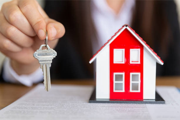 your new house, real estate agent holding house key to his client after signing contract agreement in office,concept for real estate, renting property - world title stock photos and pictures