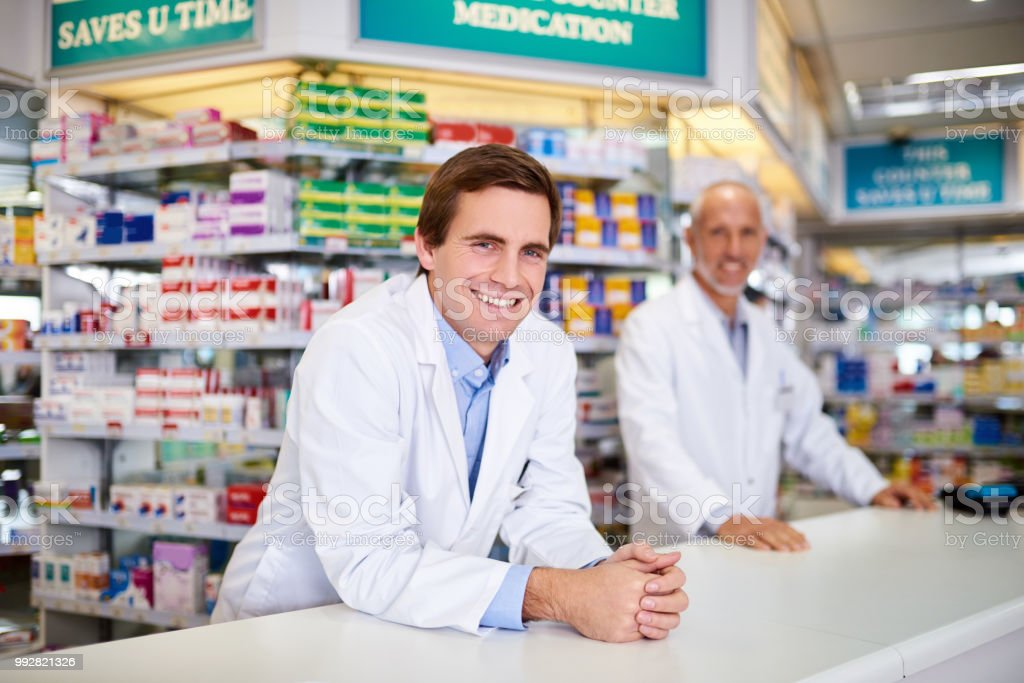 Portrait of two male pharmacists working in a chemist