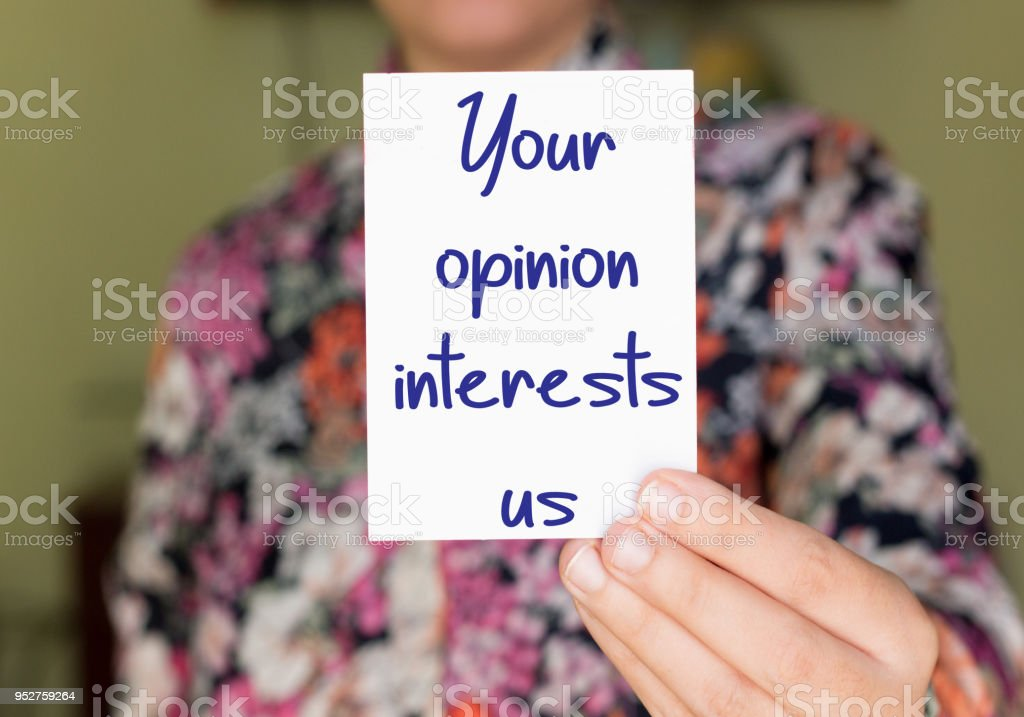 your opinion interests us on small paper stock photo