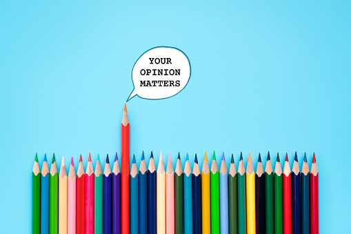 istock Your opinion matters. group of color share opinion on blue background 1096753304