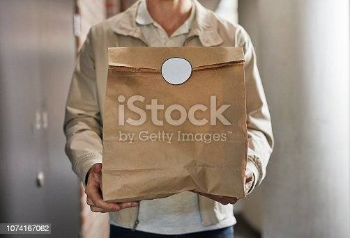 Closeup shot of a man making a home delivery