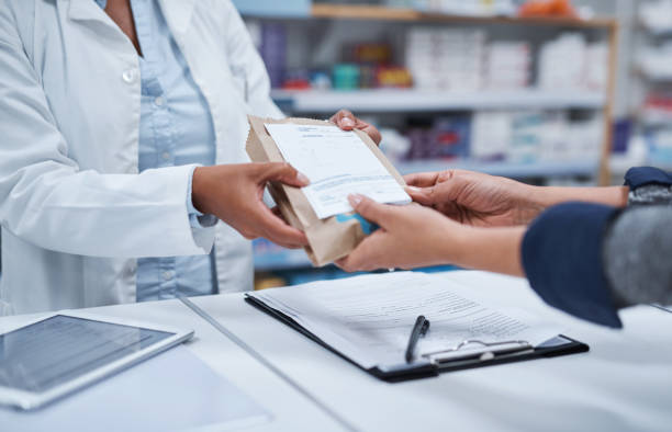 your prescription is ready for collection - pharmacy stock pictures, royalty-free photos & images