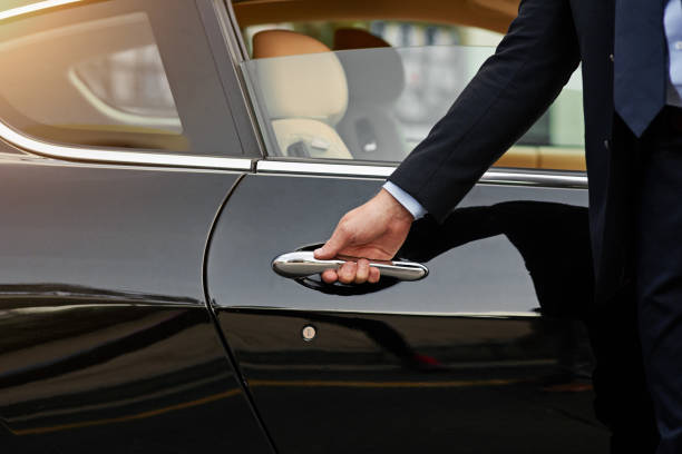 Your ride is here... Cropped shot of an unrecognizable male chauffeur opening a car door prettige verrassingen stock pictures, royalty-free photos & images