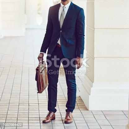 Cropped shot of a stylishly dressed businessman in the city