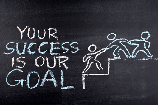 istock Your Success is our Goal hand drawing on blackboard 599107362