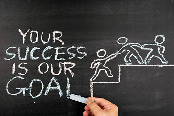 Your Success is our Goal hand drawing on blackboard stock photo