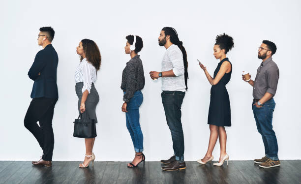 Your turn will come soon Studio shot of a group of businesspeople standing in line against a white background people in a row stock pictures, royalty-free photos & images