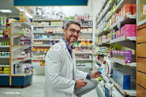 Cropped shot of a male pharmacist working in a chemist
