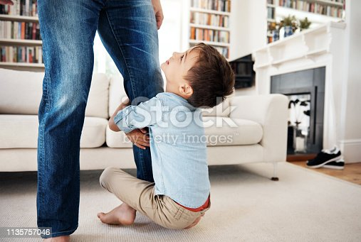 Shot of a man spending time at home with his son