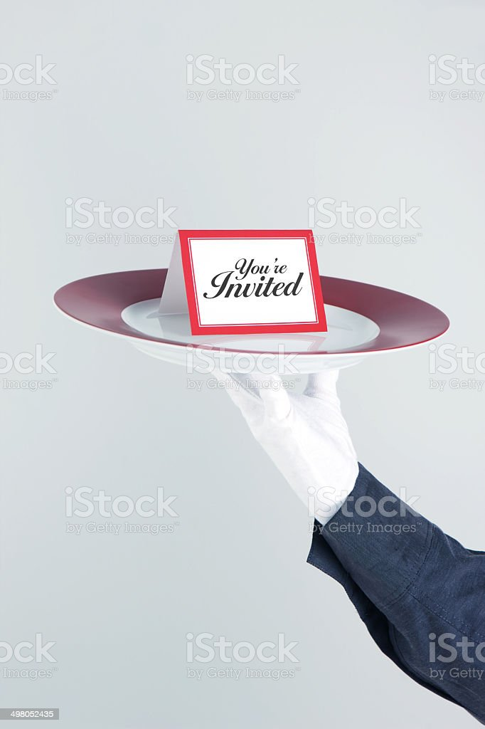 You're Invited Card On Platter Held By Waiter royalty-free stock photo