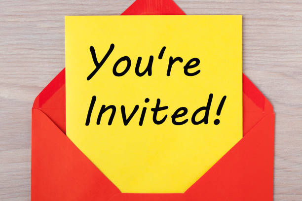 You're Invited Concept You're Invited message on letter in red envelope. guest stock pictures, royalty-free photos & images