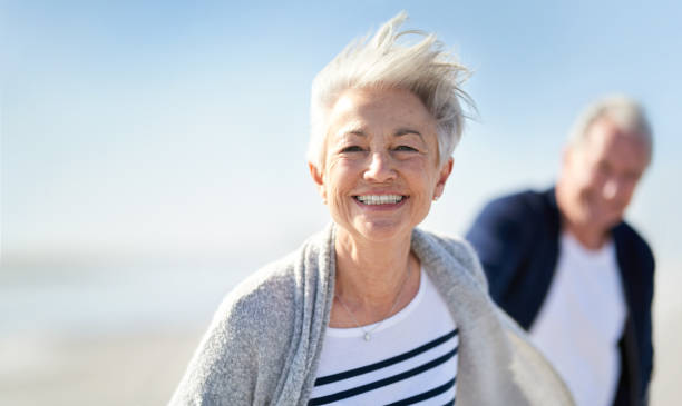 You're never too old to be young Portrait of a happy senior couple having fun at the beach young at heart stock pictures, royalty-free photos & images
