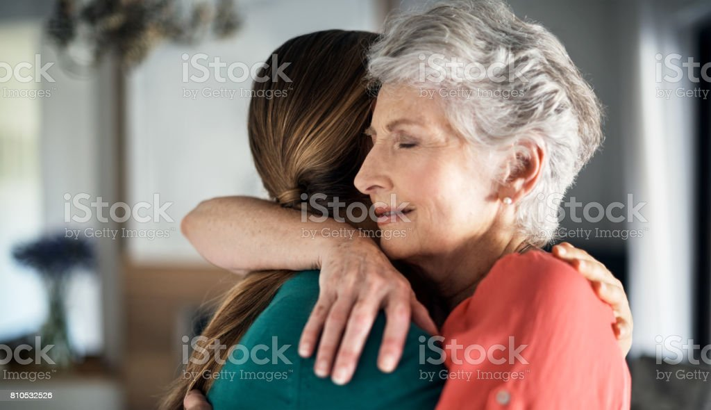 You're never too old to get a hug from mom stock photo