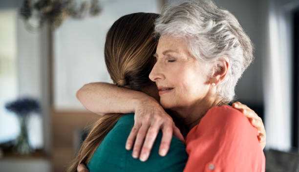 you're never too old to get a hug from mom - comfort stock photos and pictures