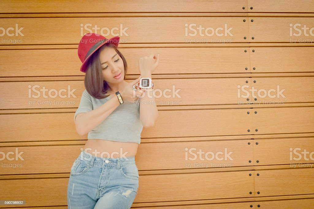 Youth and technology. Amazed young woman with smartwatch.Backgro Стоковые фото Стоковая фотография