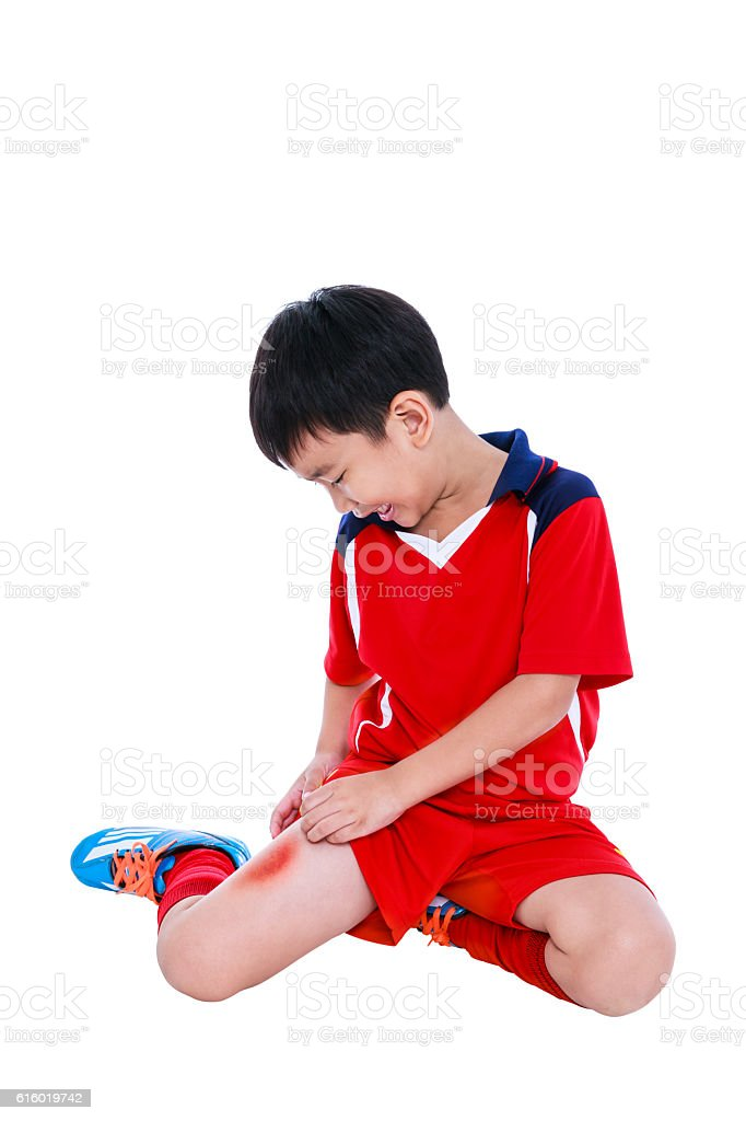 Youth asian soccer player with pain in thigh. Sport injure. - foto de acervo