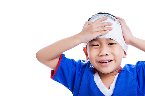youth athlete asian child with trauma of the head crying. - head injury stock photos and pictures