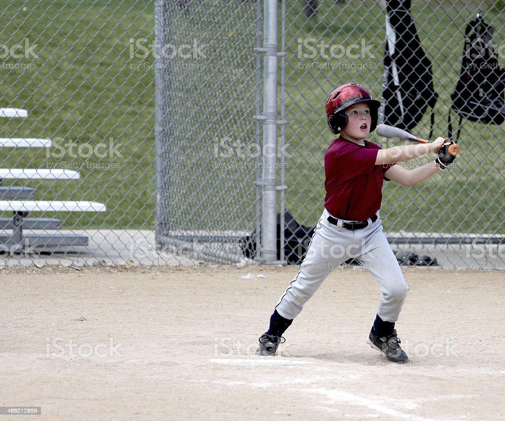 Youth baseball player at bat stock photo