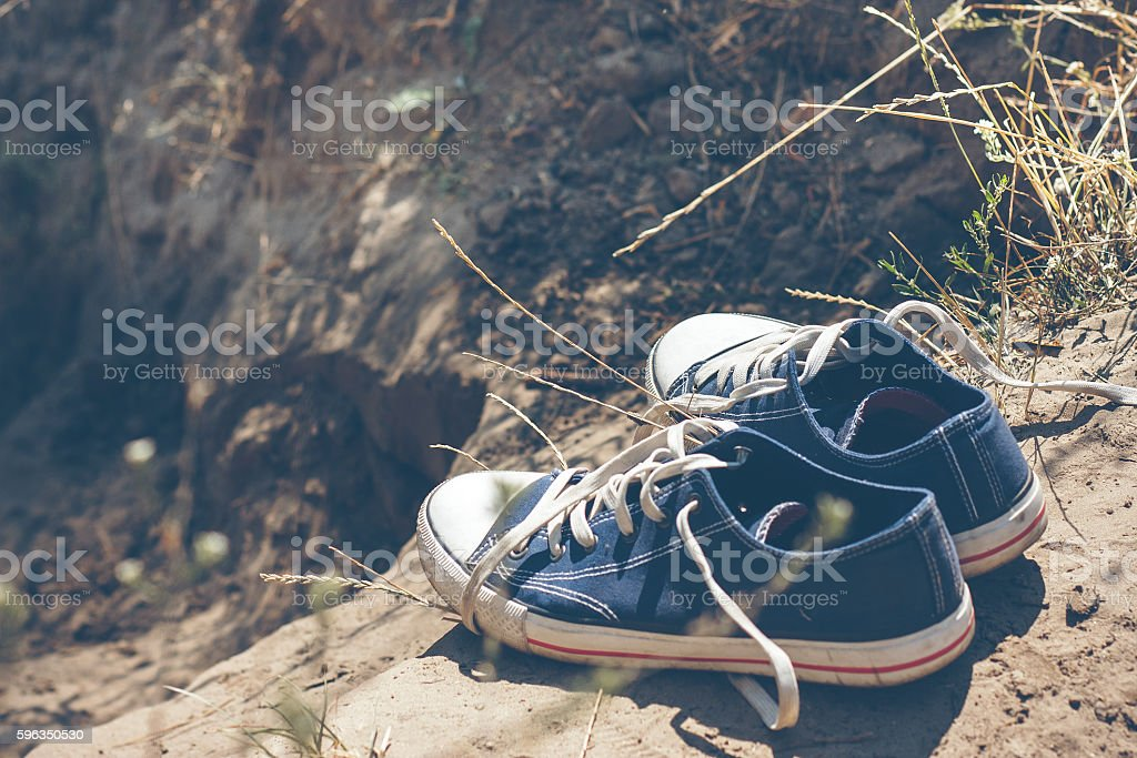 youth blue sneakers on earth royalty-free stock photo
