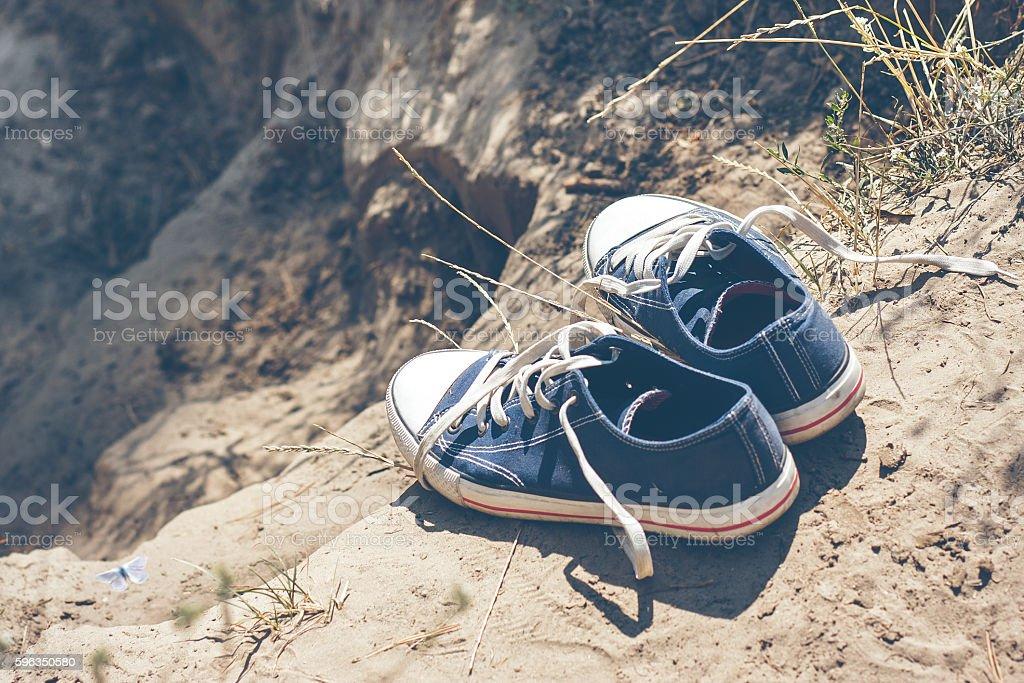 youth blue sneakers on earth Lizenzfreies stock-foto