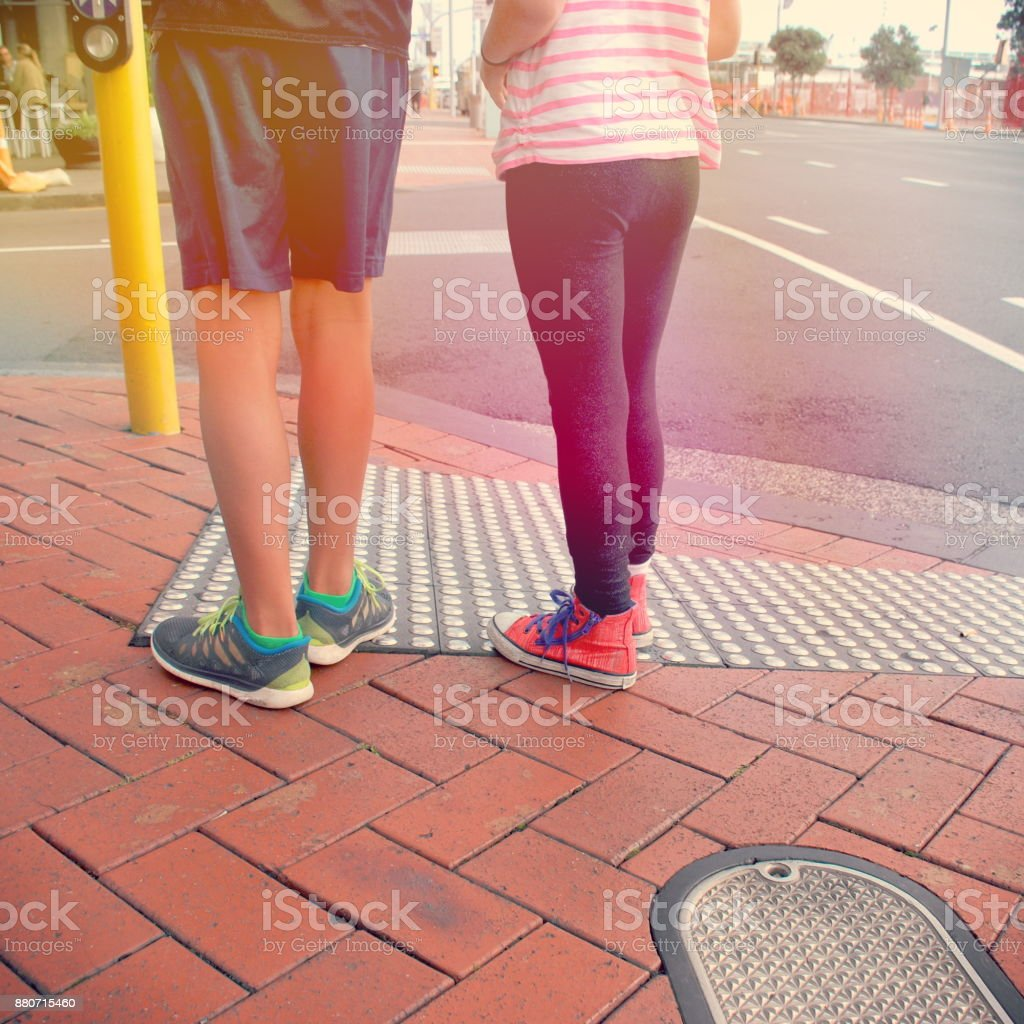 Youth Culture; Young Teenagers out on their own Crossing Road stock photo